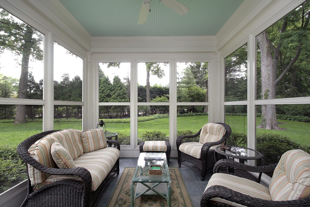 Porch in suburban home with wicker furniture